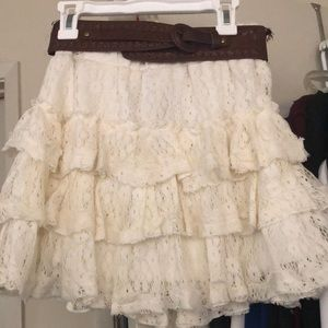 white ruffled skirt with brown belt